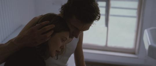 "Elizabeth Olsen stars as a young woman on the run from a cult and its leader, played by John Hawkes, in ""Martha Marcy May Marlene.''"