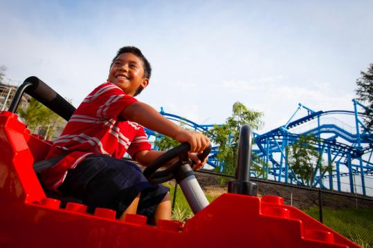 Young motorists can drive electric cars at LEGOLAND Florida, the state's newest theme park.