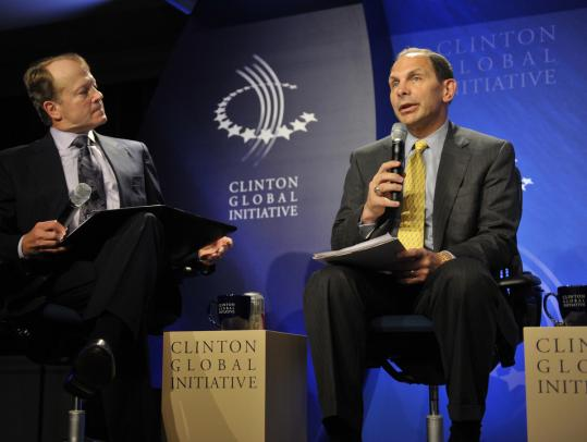 Procter & Gamble chairman Bob McDonald (right, with John Chambers, chairman of Cisco Systems) spoke during the Clinton Global Initiative meeting last month in New York. Rising costs of commodities have eaten into Procter & Gamble's first-quarter profit.