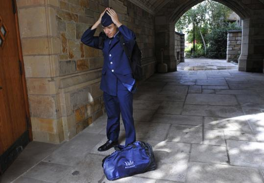 Yale sophomore Andrew Hendricks, wearing an Air Force ROTC uniform, adjusts his garrison cap on the university's campus in New Haven.