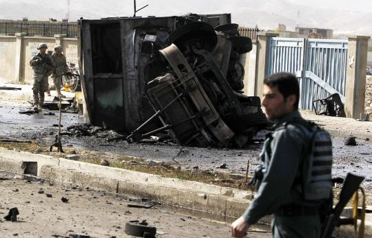 The suicide car bomb attack on a bus in Kabul yesterday killed five US soldiers, eight US contract workers, and four Afghans.
