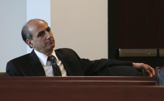 Charles Toomajian, aide to Mayor Howard, is scheduled for trial in March on a matter involving his private law firm.