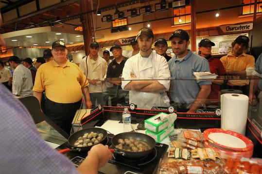 Wegmans employees learn about offerings at the Northborough store before its recent opening.