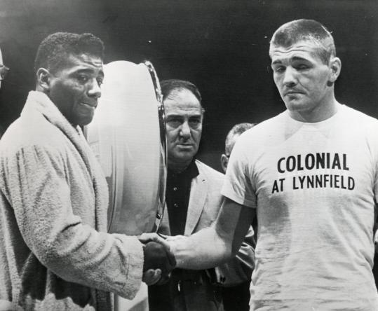 Tom McNeeley Jr. is shown shaking hands with Floyd Patterson before their fight in 1961, and working out in 1962.