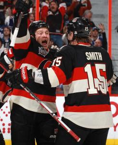Chris Neil of the Senators celebrates his second-period goal with Zack Smith during Ottawa's sixth straight victory.