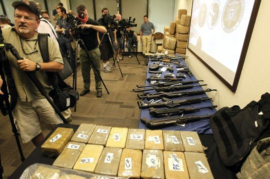 Drugs and weapons seized during a crackdown on a Mexican smuggling ring were put on display yesterday in Phoenix.