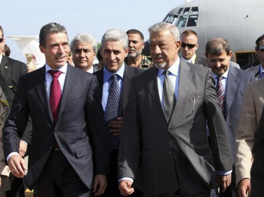 NATO Secretary General Anders Fogh Rasmussen walked with Libyan officials upon his arrival in Tripoli.