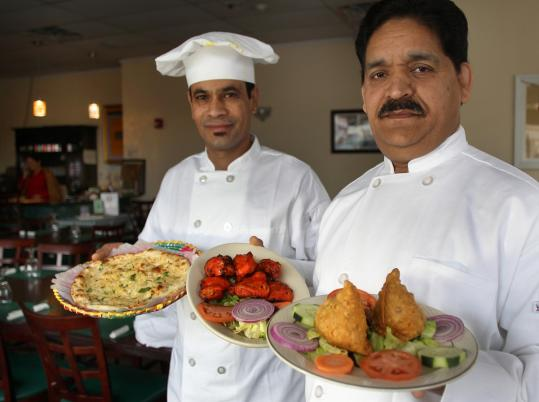 Pralad Basnet (left) and Irfan Khalid of Darbar, whose offerings include garlic naan (below left) and chicken tikka (below right).