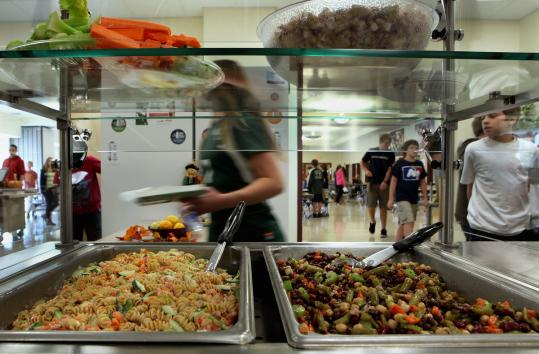 At Manchester Essex Regional Middle High School (above, below center), cafeteria fare includes healthy food made from scratch. Cambridge Rindge and Latin School (below left, right) serves as many as 700 meals a day, up from about 300 last year.
