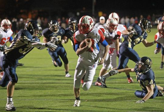 Natick's Troy Flutie calls his own number as he scores untouched for a second-quarter touchdown against Needham on Friday.