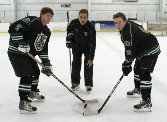 South Shore Kings players, including Greg Browne (left) and Connor Fallon, flanking coach Scott Harlow, train hard for a shot at elite college programs.