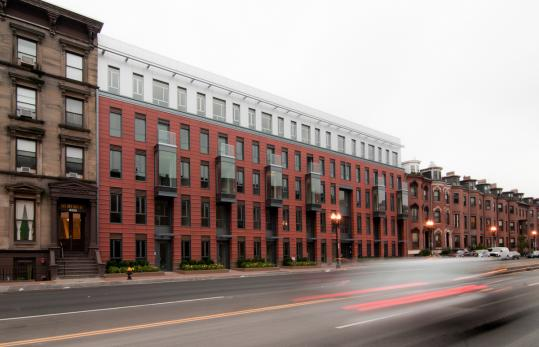 The new apartment building at 691 Massachusetts Ave. by Urbanica Inc. The façade was designed by Studio Luz.