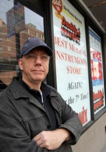 Rick Peckham, assistant chair of the guitar department at Berklee, outside the shuttered Daddy's on Mass. Ave.