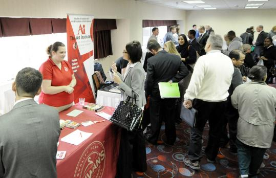 Jobless workers, like those at this job fair, have been seeking work an average of 39.4 weeks.