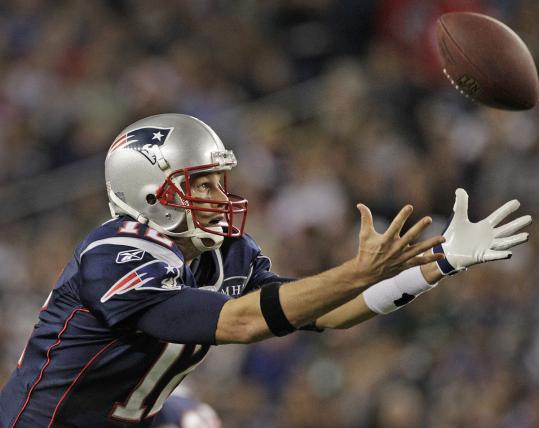 Quarterback Tom Brady did well to corral this high snap. The Patriots' defense, however, couldn't corral the Giants.