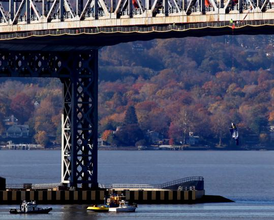 Michael Davitt, who occasionally swigged from a bottle while he dangled (at right) from the Tappan Zee Bridge, jumped from a height of about 10 feet after he was lowered by police.