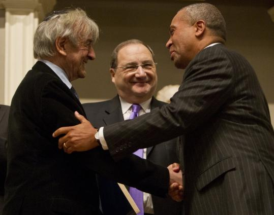 Eli Wiesel and Governor Deval Patrick exchanged greetings as Abraham H. Foxman, national director of the Anti-Defamation League, looked on after Wiesel's speech at Faneuil Hall.