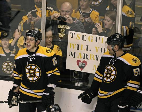 Tyler Seguin (left) had to mull a marriage proposal before he and Johnny Boychuk helped the Bruins get their third straight win.