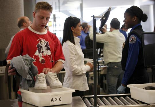 Travelers passed through airport security. For Christmas travel this year, you should get the chea