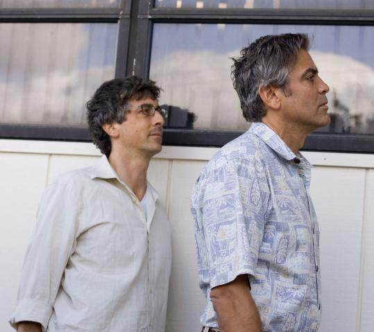 "Alexander Payne (left) and George Clooney on the set of ""The Descendants.''"