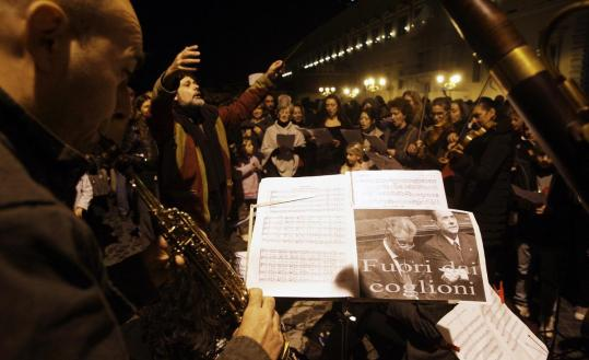"A choir and orchestra performed Handel's ""Hallelujah'' chorus outside the presidential palace in Rome after Prime Minister Silvio Berlusconi resigned."