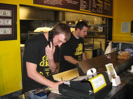 Avi Shemtov (right, with John Sullivan on phone) runs The Chubby Chickpea in downtown Canton.