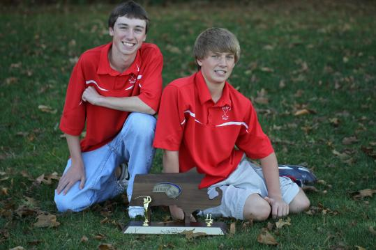 Charlie May (left) and his younger brother George are key players on the Masconomet Regional High School golf team, which won the Division 2 state championship.