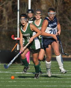 Duxbury's Lily Smith (31) heads upfield, chased by Walpole's Bridget Nicholson.