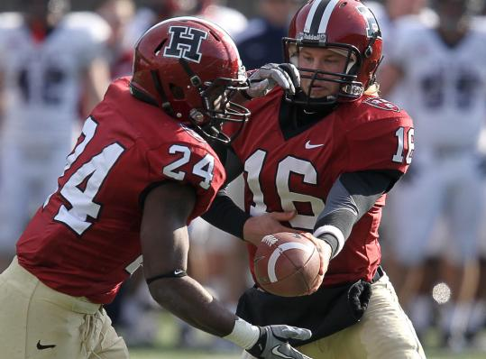 Harvard quarterback Collier Winters got a lot of help from his backfield, including Treavor Scales (left), who rushed for 70 yards.