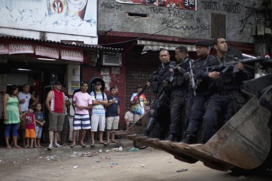 The operation in the Rocinha slum in Rio de Janeiro is part of an effort to increase security before the World Cup and Olympics.