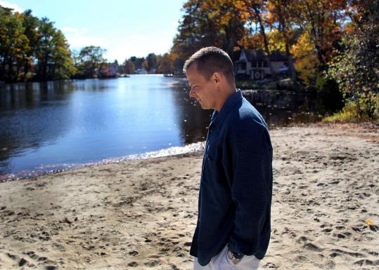 Derek Frechette walked along the Sturbridge Recreation Camp on Cedar Lake, near the spot where his son Christian drowned.