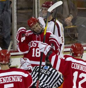 BU's Wade Megan (18) celebrates a first-period strike, the first of his two goals against BC.