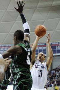 UConn's Shabazz Napier gets a shot off over the reach of Wagner's Naofall Folahan.