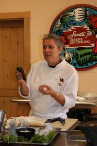 Deena Chafetz teaches a chile workshop at Santa Fe School of Cooking. Below: peppers for sale from farmer Matt Romero.