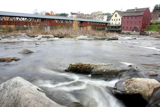 The Riverwalk loop off Mill Street includes a pedestrian covered bridge over the Ammonoosuc River. Below: Littleton's Main Street has ample shopping, and Cannon Mountain is nearby in Franconia Notch State Park.