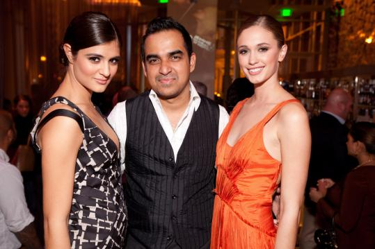 Designer Bibhu Mohapatra with models Marcella Sacco (left) and Kacy Emmett at the W Hotel last night.