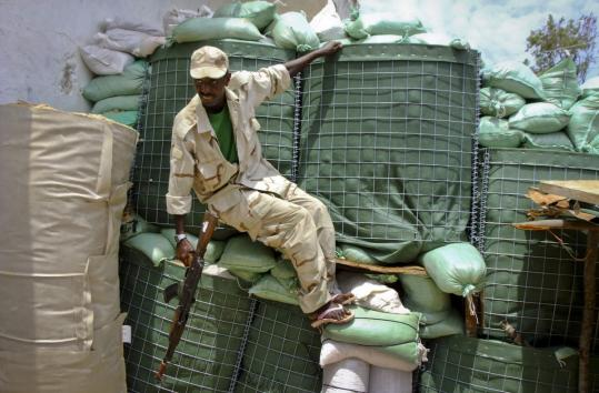 A Somali government soldier moved into position yesterday during a skirmish with militants.
