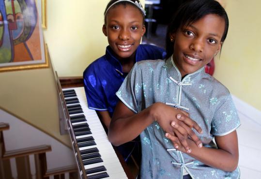 Oladunni (left) and Olayeni Oladipo, at home in Canton.