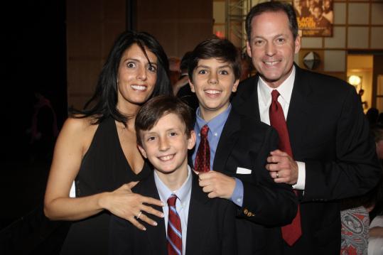 Robin and Tripp Jones of Wayland and their children Tucker (left) and Hugh.