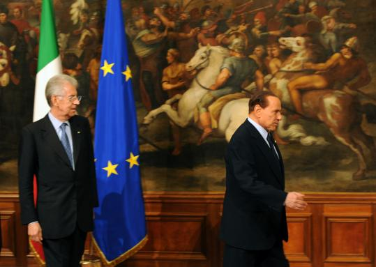 Italy's new prime minister, Mario Monti (left), was sworn in yesterday, formally ending Silvio Berlusconi's government.