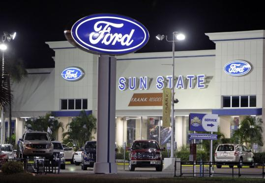 New cars are seen on display at a Ford dealership in Orlando. Analysts say normally sleepy November is shaping up to be the strongest month for US auto sales this year.