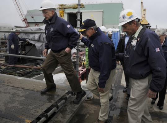 Defense Secretary Leon Panetta, center, toured the Virginia-class submarine Mississippi yesterday during a visit to the shipyard of Electric Boat in Groton, Conn.