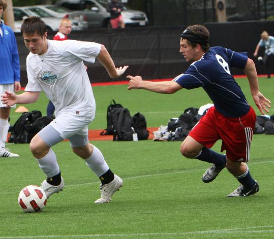 Needham High junior Mac Steeves (left) in action during the offseason for the FC Greater Boston Bolts.