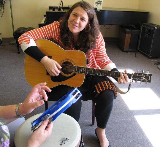 Music therapist Romy Ikauniks Wilhelm of Arlington works at the Indian Hill Music School in Littleton.