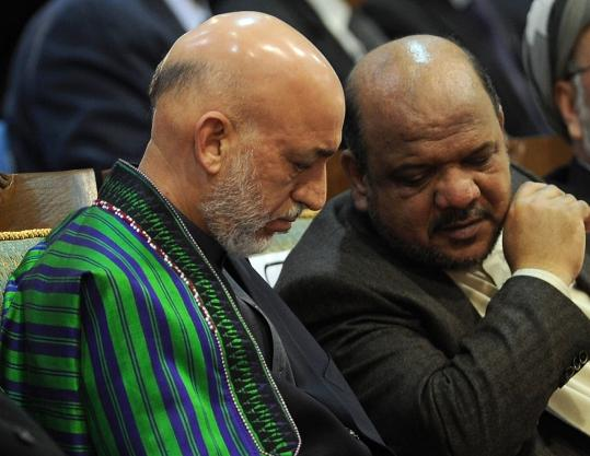 Afghan President Hamid Karzai (left) and Vice President Mohammad Qaseem Fahim during the last day of a four-day meeting with tribal elders and leaders in Kabul.
