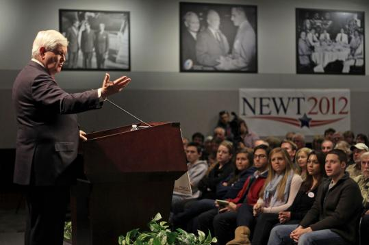 Newt Gingrich, speaking at Saint Anselm College, said his plan would let people control their own retirement investments.