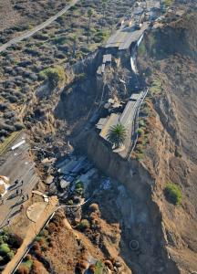 Officials say the section of a coastal bluff road in San Pedro, Calif., south of downtown Los Angeles, that collapsed in a landslide after Sunday's heavy rain is probably irreparable.