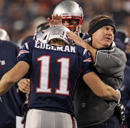Julian Edelman gets some kudos from coach Bill Belichick after Edelman returned a punt 72 yards for a touchdown in the second half.
