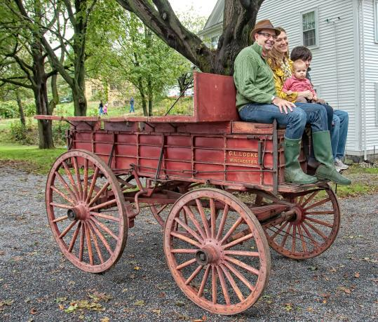 Leo and Lia O'Donnell and their children atop a Wright-Locke Farm wagon. Below, a closer look.
