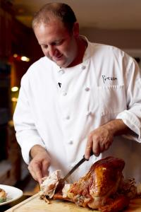 At his home in Saugus, Prezza chef Anthony Caturano demonstrates how to carve the cooked bird.